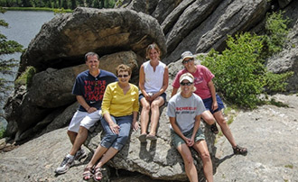 Family sitting on large rocks